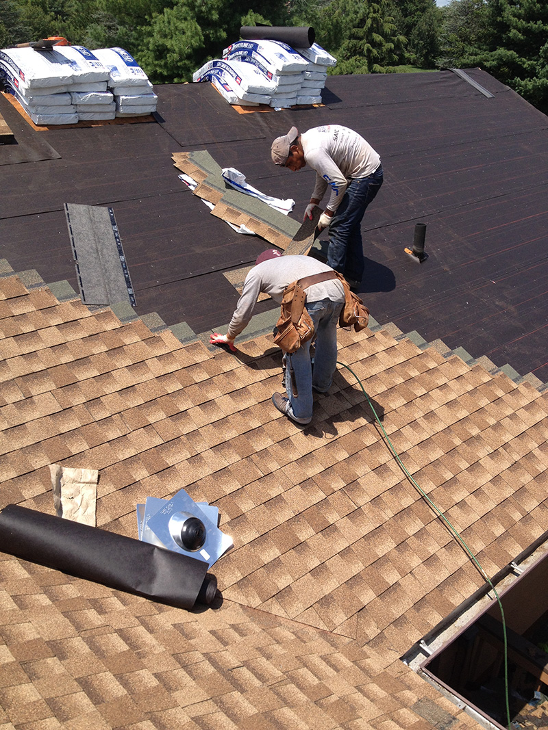 Roof Contractor Replacing Roof In Highland Area